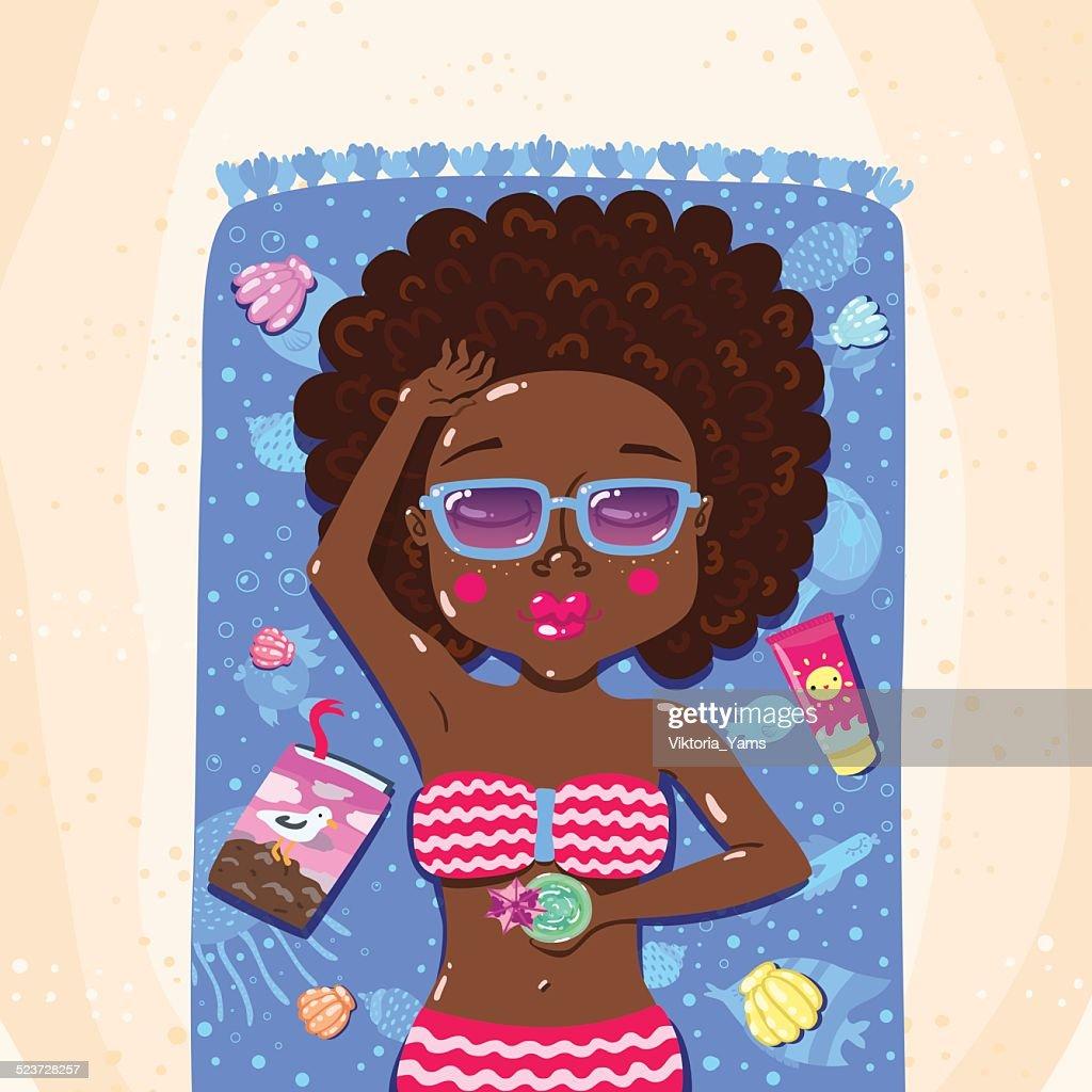 Summer girl sunbathes on the beach