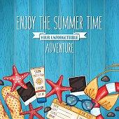 Summer travel wooden background with beach accessories