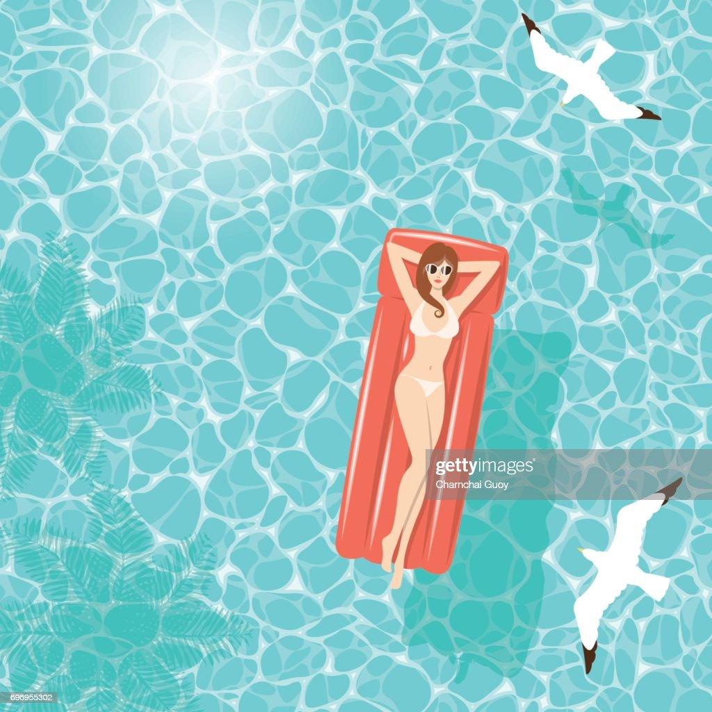 Summer woman on air mattress in the sea