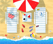 Sun beds and parasol on seaside