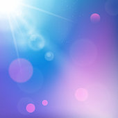 Sun rays on blue and purple colored background