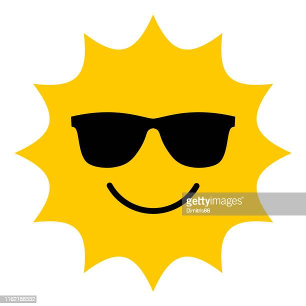 sun with sunglasses smiling icon - sunglasses stock illustrations