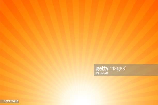 sunbeams: bright rays background - orange background stock illustrations