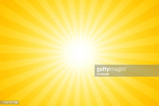 sunbeams: bright rays background - yellow background stock illustrations