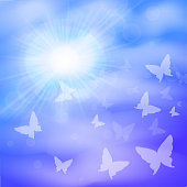 Sunny background, blue sky, white clouds of butterfly and sun.
