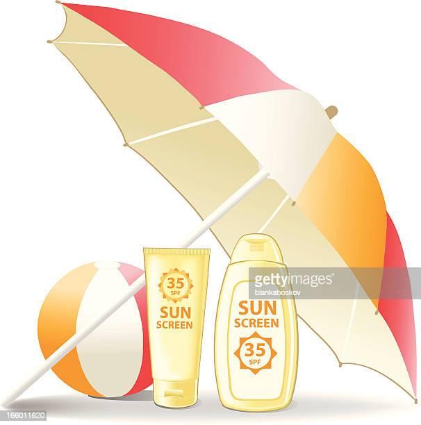 Sunscreen and beach ball below a sunshade