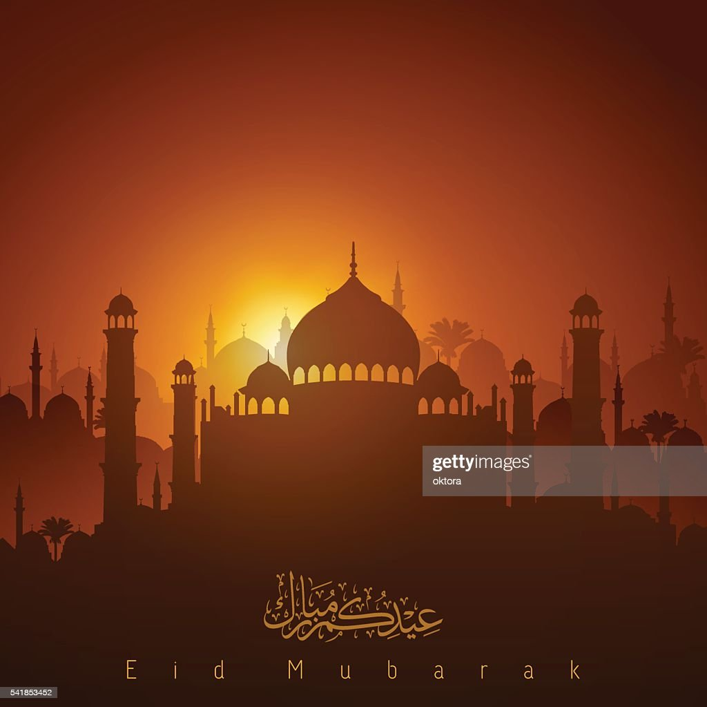 Sunset on mosque silhouette and arabic calligraphy Eid Mubarak