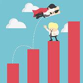 Super businessman in red jump bar chart. Business concept.