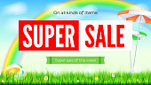 Super sale summer background. Sale of all items. Rainbow above green field. Grass, daisy flowers, ladybugs in grass on backdrop from sky with clouds. Landscape with solar umbrella and inflatable ball