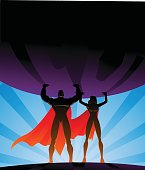 Superhero Couple Lifts a Big Globe in Silhouette