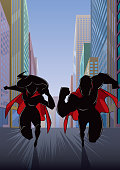 Superhero Couple Running in City Silhouette