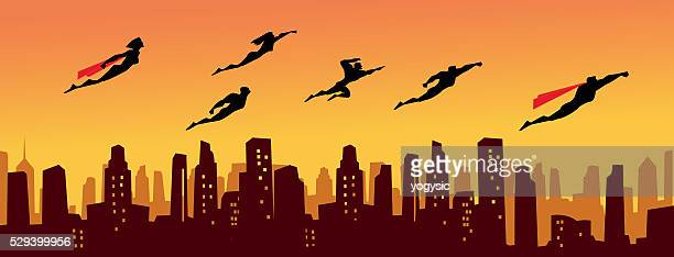 superhero legion above the city - superhero stock illustrations