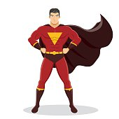 Superhero Standing with Cape Waving in the Wind