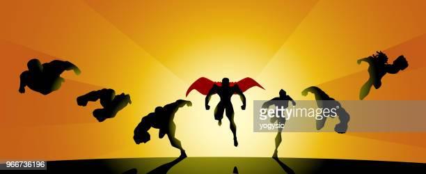 superhero team silhouette charging forward - action movie stock illustrations
