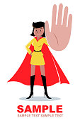 Superhero young women (African ethnicity or African-american ethnicity) gesturing stop hand sign and standing with hand on hip