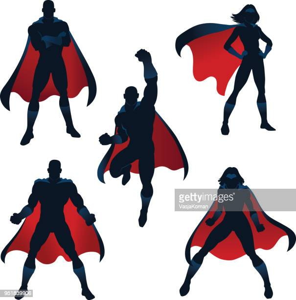 superheroes silhouettes in red and blue - heroes stock illustrations