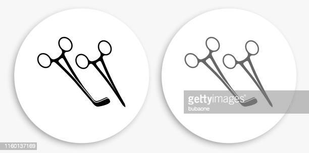surgical scissors black and white round icon - surgical equipment stock illustrations