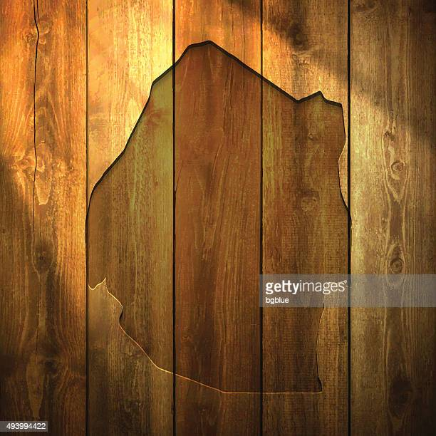 swaziland map on lit wooden background - eswatini stock illustrations, clip art, cartoons, & icons