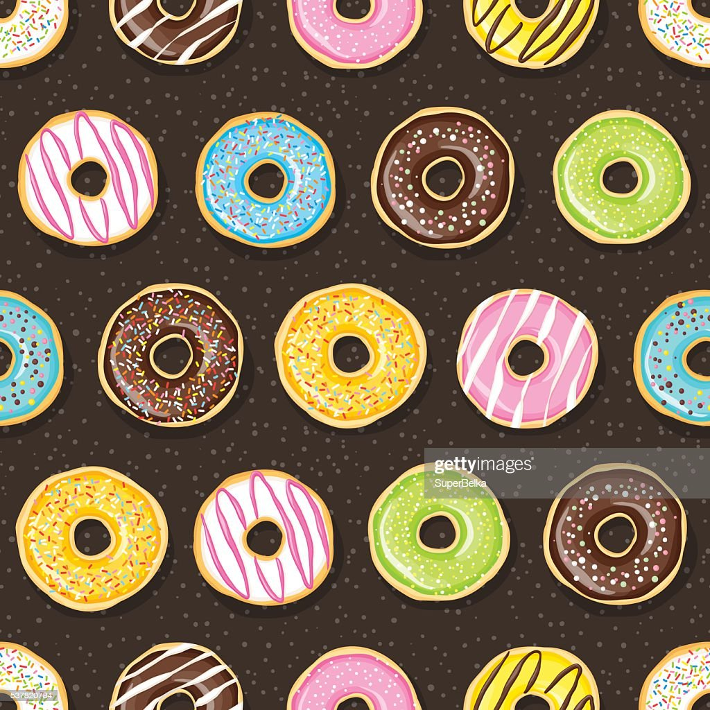 Sweet donuts on the dark background.