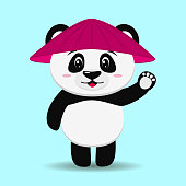 A sweet panda wearing a cartoon-style hat stands with a raised hand.
