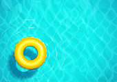 Swimming pool with rubber ring for swim. Sea water. Ocean surface wave.