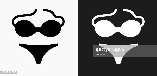 swimsuit icon on black and white vector backgrounds - swimwear stock illustrations, clip art, cartoons, & icons