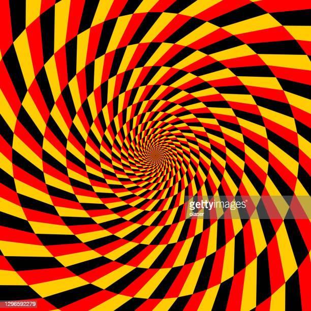 wirbel plus kreisförmiges muster aus polygonen in den farben rot, schwarz und gelb - deutsche flagge stock-grafiken, -clipart, -cartoons und -symbole