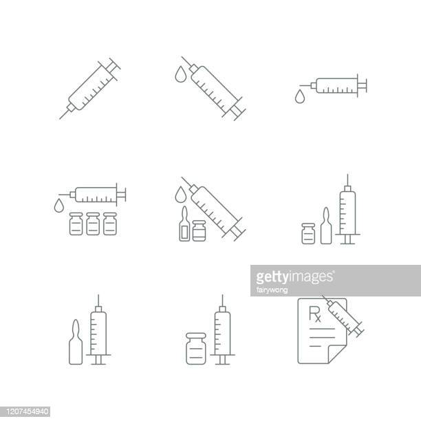 syringe injection icon - injecting stock illustrations