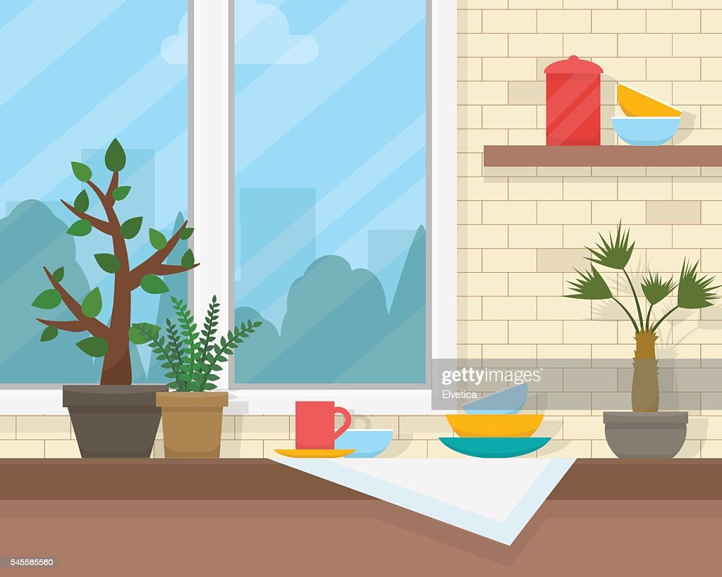 Table and window with house plants