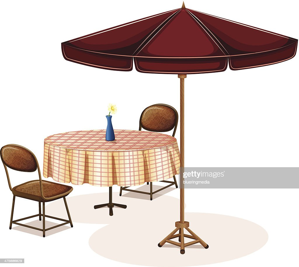 table with an umbrella in cafe