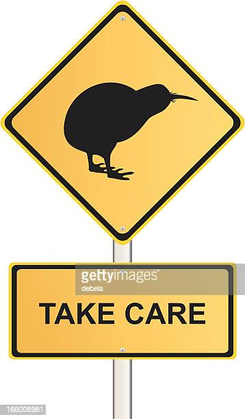 take care kiwi road sign - animal crossing sign stock illustrations