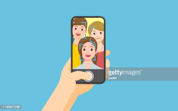 taking photo on smartphone - young adult stock illustrations