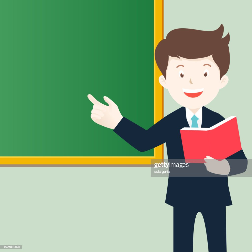 Teacher holding book pointing green board