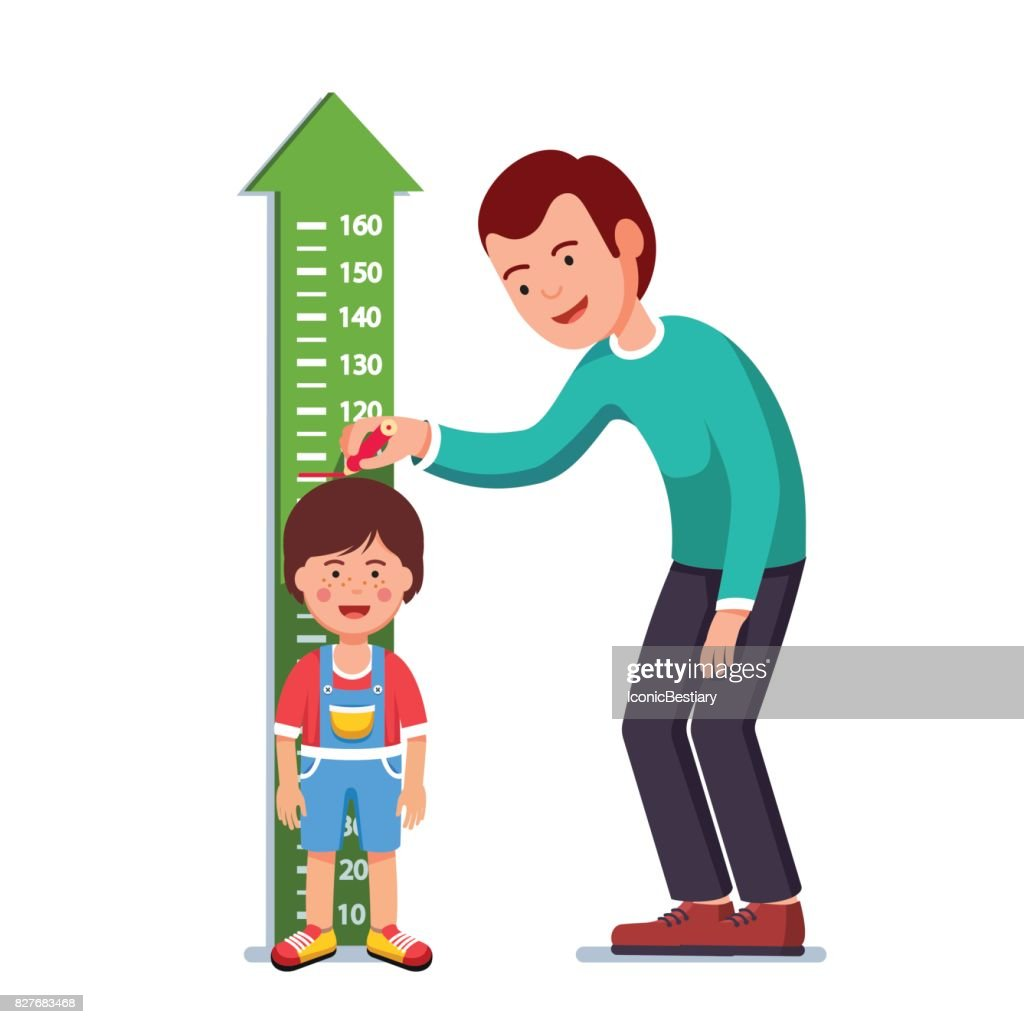 Teacher or father measuring boy kid height