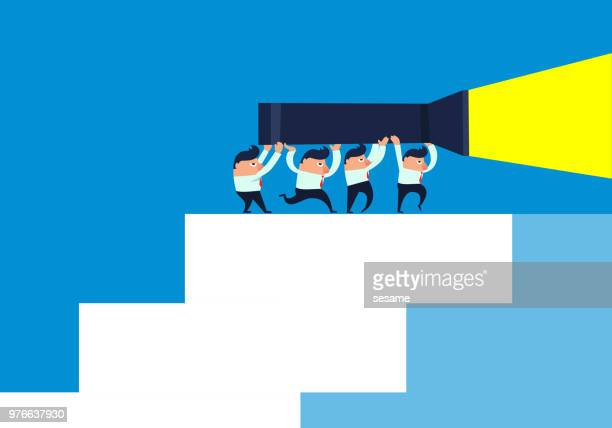 Team holding flashlight climbing stairs