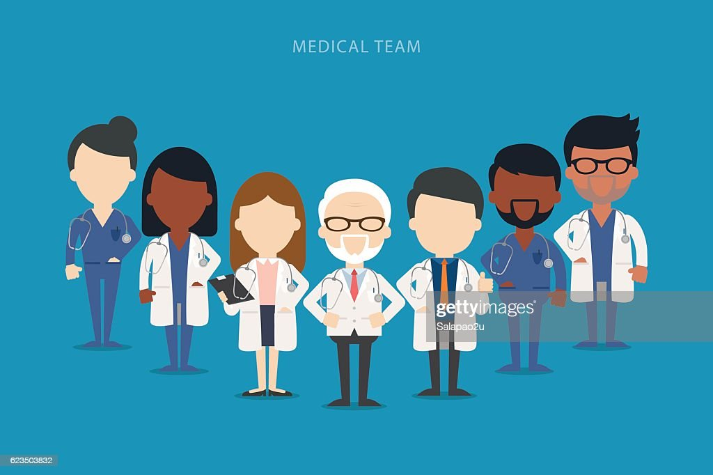Team of doctors and other hospital workers stand together.
