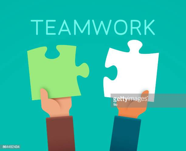 Teamwork Puzzle Piece Hands