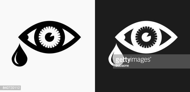 tears icon on black and white vector backgrounds - teardrop stock illustrations