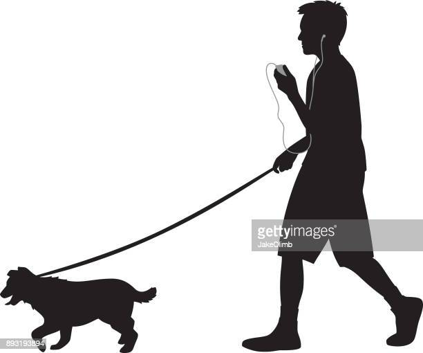 teen walking dog with headphones silhouette - dog leash stock illustrations, clip art, cartoons, & icons