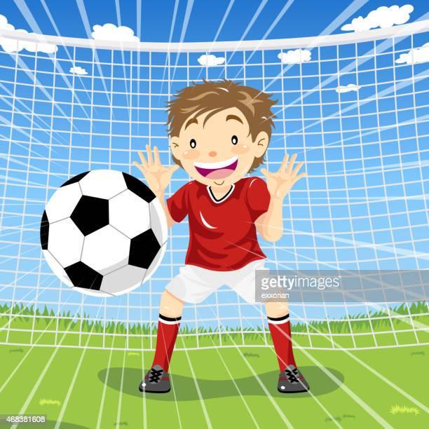 Teenage boy goalie catching soccer ball