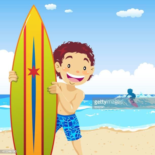 Teenage boy holding surfboard