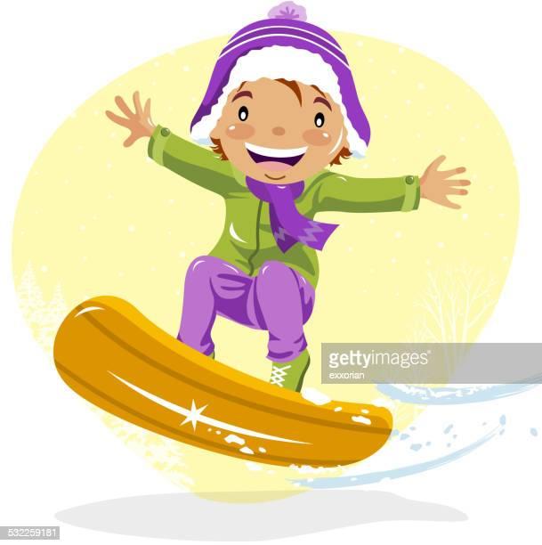 Teenage Boy Snowboarding in Winter