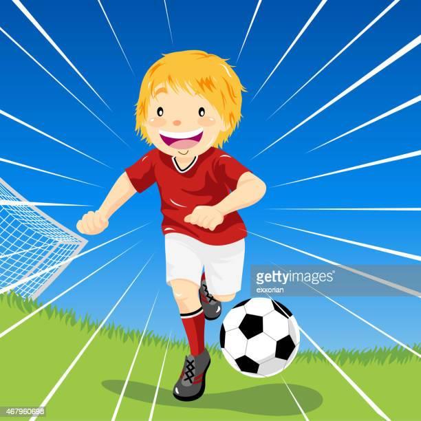 Teenage Boy Soccer Dribbles Down the Field
