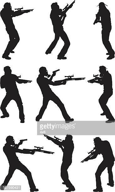 Terrorist wearing gas mask with guns