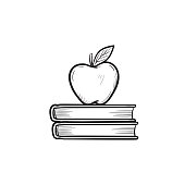Text books and apple hand drawn sketch icon