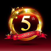 th golden anniversary logo. with ring and red ribbon.