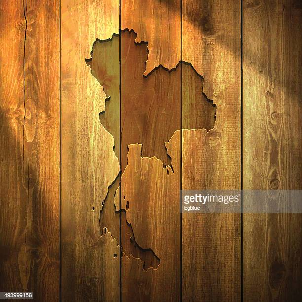 Thailand Map on lit Wooden Background