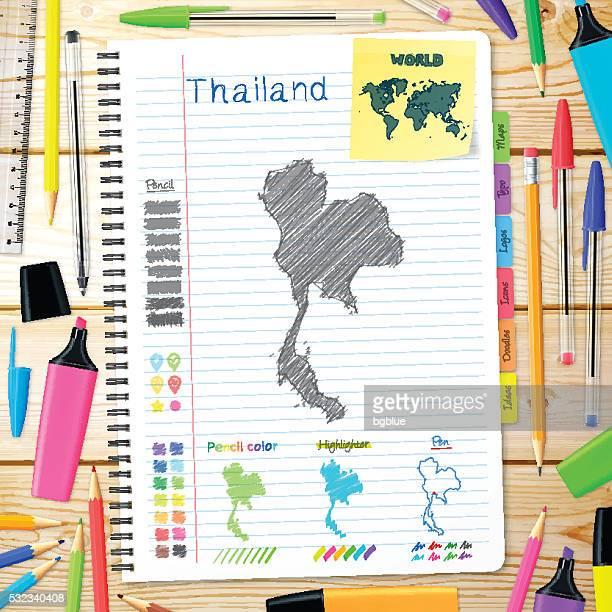 Thaïlande cartes dessinées à la main sur ordinateur portable. Fond de bois