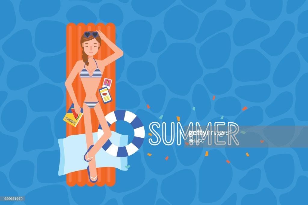 The bikini girl on the airmattress at the swimmingpool.
