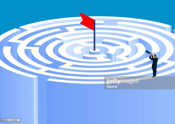 the businessman climbed to the top of the maze and tried to find the way to the end - information medium stock illustrations